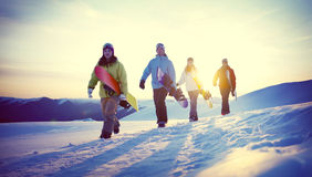 Group of Snowboarders on Top of the Mountain Concept Stock Photography