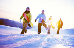 Group of Snowboarders on Top of the Mountain Concept stock image