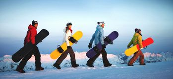 Group of snowboarders on top of the mountain. stock photography