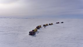 A group of snowmobiles is walking along the snowy plain. Snow convoy. Antarctic. royalty free stock photo
