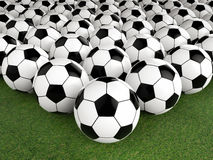 Group of soccer balls on green field. 3d rendering group of soccer balls on green field Stock Images