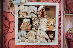 Group of soft stuffed toys on  shelf Stock Photos