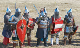 Group of soldiers in an armor and with the weapon Royalty Free Stock Photography