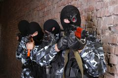 Group of soldiers in black masks with guns Royalty Free Stock Photography