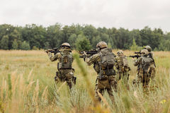 Group of soldiers conducting an offensive against the enemy Stock Photo