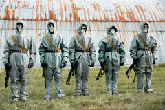 A group of soldiers with guns in their masks and protective clot Royalty Free Stock Images