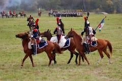 Group of soldiers-reenactors ride horses. Stock Photo