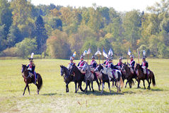 Group of soldiers-reenactors ride horses. Royalty Free Stock Images