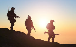 Group of soldiers. Silhouette of a group of soldiers at sundown Stock Images