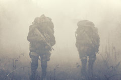 Group of soldiers in the smoke Stock Photos