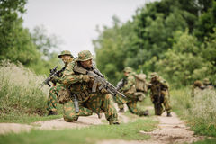 Group of soldiers special forces during the raid in the forest. Group of soldiers Russian special forces during the raid in the forest Royalty Free Stock Photography