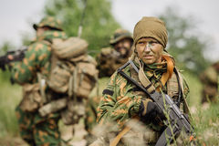 Group of soldiers special forces during the raid in the forest Royalty Free Stock Image