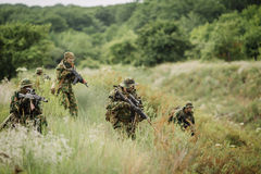 Group of soldiers special forces during the raid in the forest Royalty Free Stock Photos