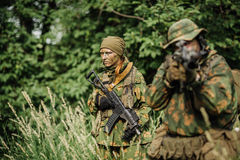 Group of soldiers special forces during the raid in the forest Stock Image