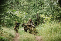 Group of soldiers special forces during the raid in the forest Stock Photography
