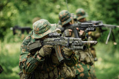 Group of soldiers special forces during the raid in the forest. Group of soldiers Russian special forces during the raid in the forest Stock Image