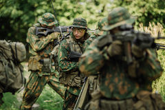 Group of soldiers special forces during the raid in the forest Stock Photo
