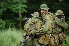 Group of soldiers special forces during the raid in the forest Royalty Free Stock Photography