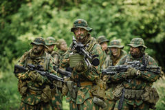 Group of soldiers special forces during the raid in the forest Stock Images
