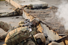Group of soldiers was ambushed and returned fire leads Royalty Free Stock Photography