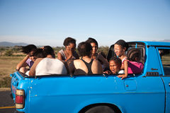 Group of South African people travelling in the back of a pickup Stock Images