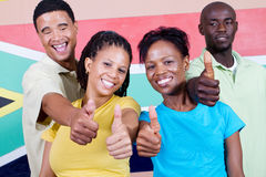 Group of South Africans. Group of young happy South Africans people in front of South Africa flag, 2010 FIFA world cup concept stock photography