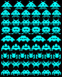 A group of space invaders. Blue silhouettes of a group of space invaders on a black background Stock Photo