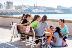 A group of Spanish, female teenagers meet after school to talk t Royalty Free Stock Photos