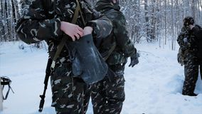 Group of special forces weapons in cold forest. Clip. Soldiers on exercises in the forest in the winter. Winter warfare stock photo