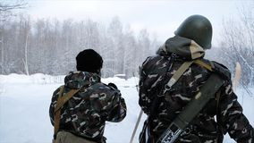 Group of special forces weapons in cold forest. Clip. Soldiers on exercises in the forest in the winter. Winter warfare royalty free stock photography