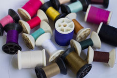Group of spools of thread of various colors. Isolated on white background Stock Images