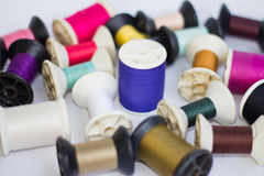 Group of spools of thread of various colors. On white background Stock Images
