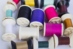 Group of spools of thread of various colors. On white background Stock Image