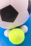Group of sport balls. Soccer, tennis and table tennis balls grouped on blue background Royalty Free Stock Image