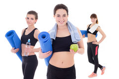 Group sport concept - beautiful slim sporty women with yoga mat Stock Images