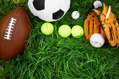 Group of sport equipment. On green grass Stock Photos