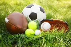 Group of sport equipment. On green grass Royalty Free Stock Image
