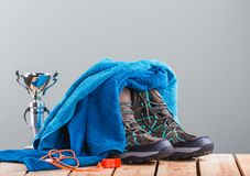Group of sport objects- trekking shoes, towel, goblet and whistle. Composition with trekking shoes, blue towel, metallic goblet and red plastic whistle on the royalty free stock images