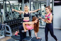 A group of sport women working out in the gym. stock image