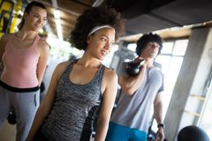 Group of sportive people in a gym. Concepts about lifestyle and sport in a fitness club royalty free stock photography