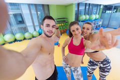 Group of sportive people in a gym taking selfie Stock Images