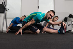Group Of Sportive People In A Gym Training Royalty Free Stock Photo