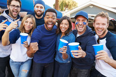 Group Of Sports Fans Tailgating In Stadium Car Park Stock Image