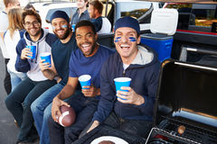 Group Of Sports Fans Tailgating In Stadium Car Park Royalty Free Stock Images