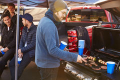 Group Of Sports Fans Tailgating In Stadium Car Park stock photos