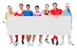 Group of sports people presenting empty banner. Isolated on white Stock Images