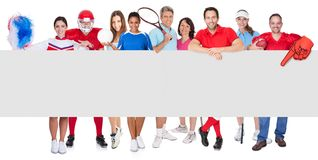Group of sports people presenting empty banner. Isolated on white Royalty Free Stock Photography