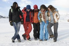 Group of sports teenagers in mountains Royalty Free Stock Image