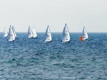 A group of sportsmans on small sailing yachts trains on the Mediterranean Sea near the coast of Nahariyya in Israel. Nahariyya, Israel - Februar 10, 2018 : A Royalty Free Stock Photography