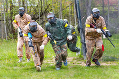Group of sportsmen on start of paintball mission Royalty Free Stock Image